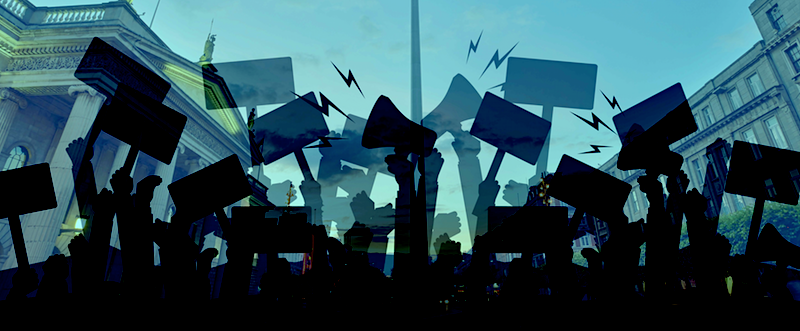 Independent Left is a new movement for environmentalism, socialism, freedom and equality. #liveablecity. Its members include Councillor John Lyons, Niamh McDonald and Conor Kostick. The image is a blue-tinted background of the GPO, O'Connell Street, with the silhouettes of demonstrators waving placards in the foreground.