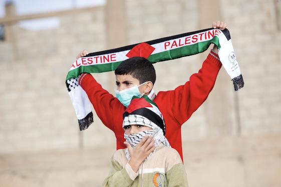 Palestine child with scarf