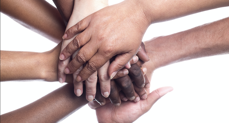 Black and white hands united against racism
