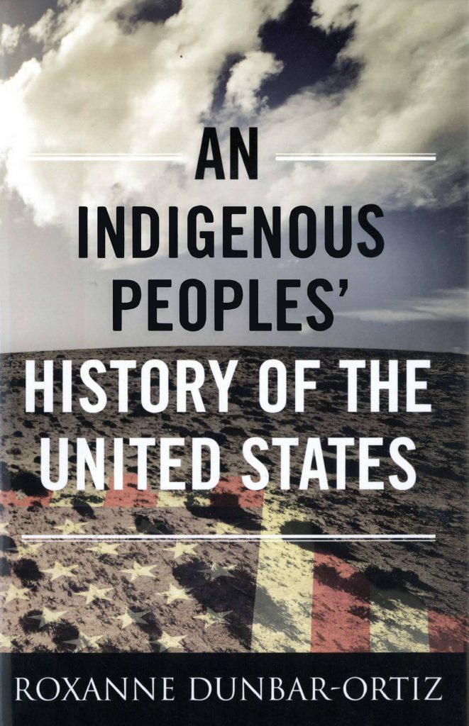 The cover of Roxanne Dunbar-Ortiz's An Indigenous Peoples' History of the United States. A cloudy sky, distant horizon and savanna on which is the faded US flag form the background to the text.