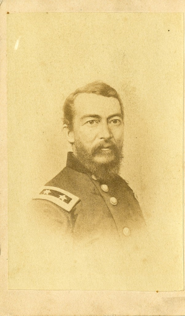 Sepia portrait of General Philip Sheridan of the Union army. He is looking past the right shoulder of the viewer, wearing a Union army jacket with two stars conspicuous on the left shoulder, which is nearest the viewer, as he is posed at an angle. He is bearded and has a thick moustache.