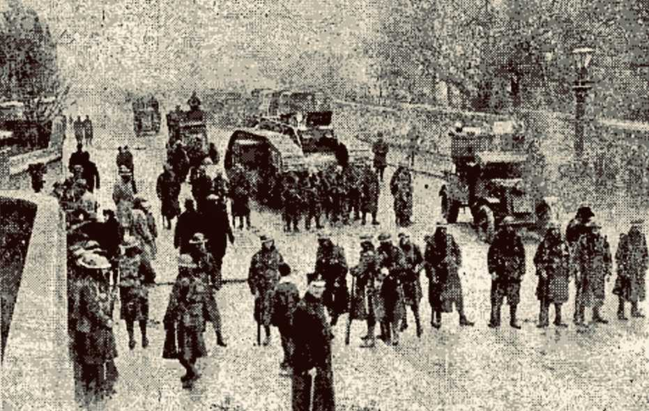 Newspaper picture from 1920 of a tank and a think line of British Troops near Mountjoy Prison, April 1920.