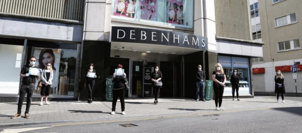 Debenhams workers in masks picket line