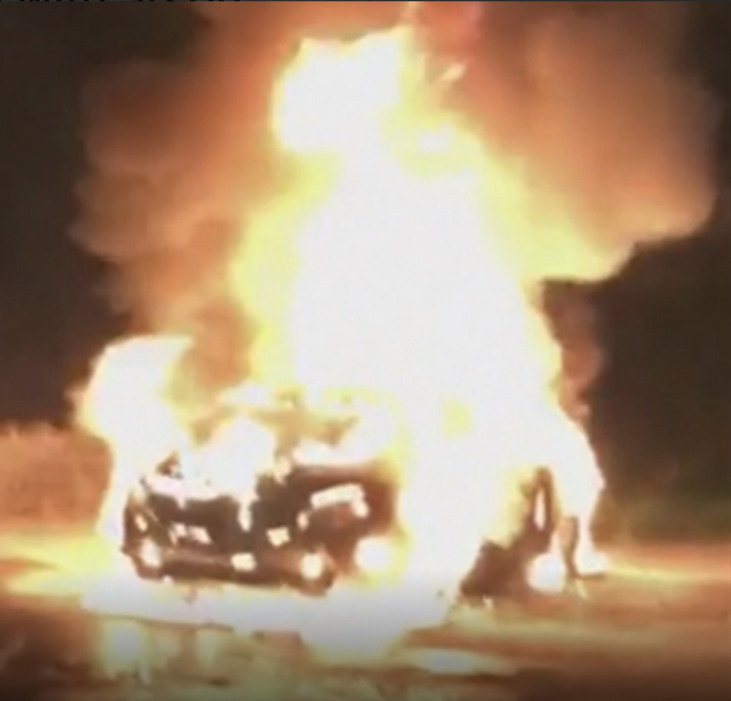 Martin Kenny's car is barely visible inside a ball of bright yellow flame that is engulfing it and burning to a height of around 20 metres. On 28 October 2019, the car of Sinn Féin TD Martin Kenny was set on fire after he spoke out in support of people seeking asylum