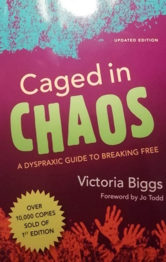 Cover of the book about dyspraxia Caged in Chaos by Victoria Biggs